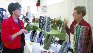 Phyllis Beaver talkes to Sandra Sisk about her handmade scarves. Jeanie Groh/Salisbury Post